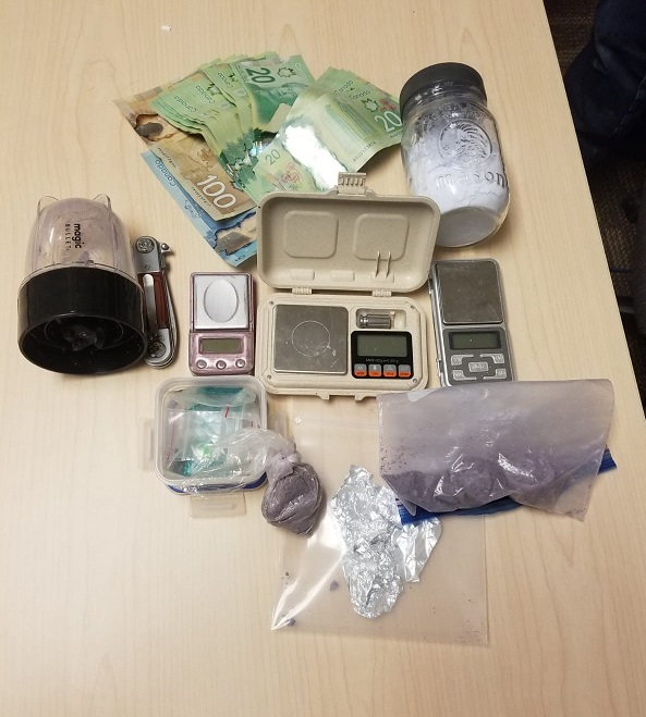 Kingston police charge two people with possession for the purpose of trafficking after they find $40,000 worth of fentanyl, cash, and drug paraphernalia.