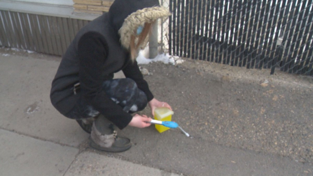Amanda Sauer, the AIDS Program South Saskatchewan (APSS) education co-ordinator, picks up a needle.