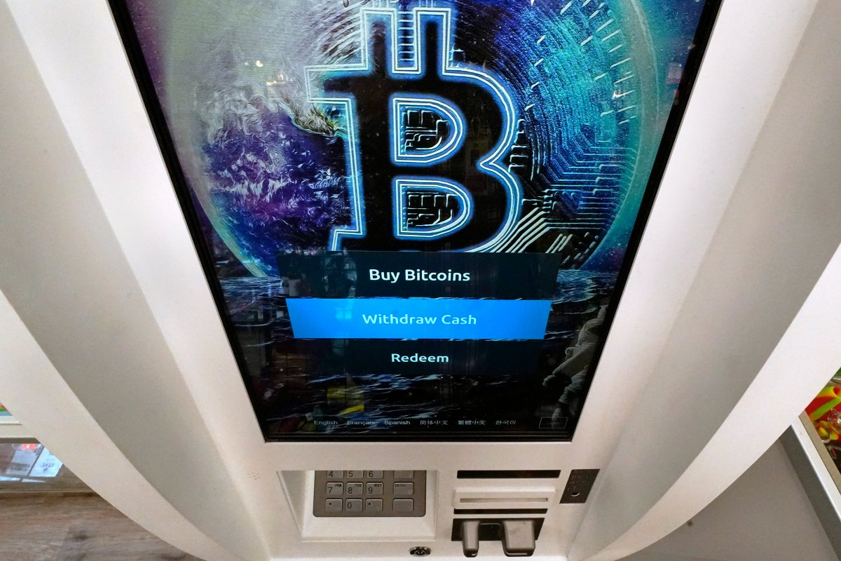 The Bitcoin logo appears on the display screen of a crypto currency ATM at the Smoker's Choice store, Tuesday, Feb. 9, 2021, in Salem, N.H.