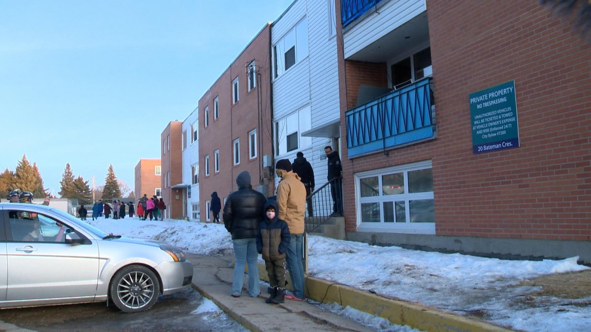 Residents of a Saskatoon apartment stand outside after being evacuated for the second time in two months due to dangerous carbon monoxide levels.