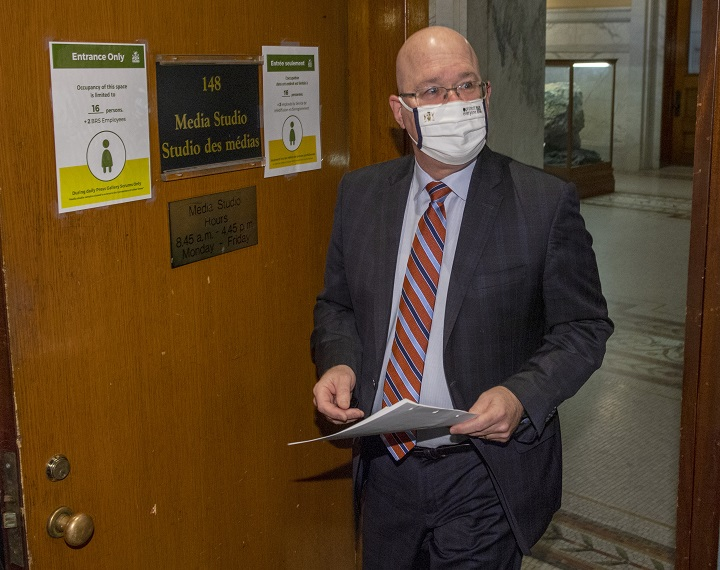 Minister of Municipal Affairs and Housing Steve Clark arrives to make an announcement in the Ontario Legislature, in Toronto, Monday, Dec. 7, 2020.