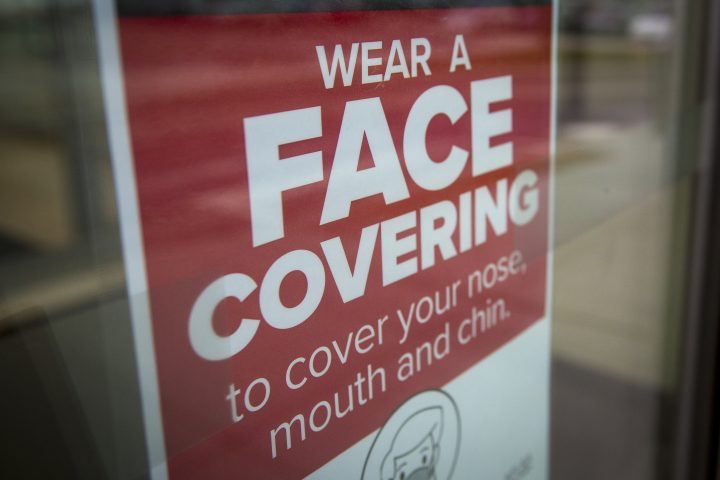 A sign advising to wear a face covering at a shopping centre in Kingston, Ontario on Thursday, December 10, 2020.