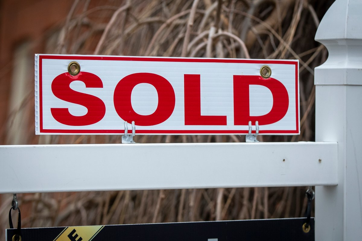 A real estate sold sign on a property in Kingston, Ontario on Wednesday, March 3, 2021. THE CANADIAN PRESS IMAGES/Lars Hagberg.