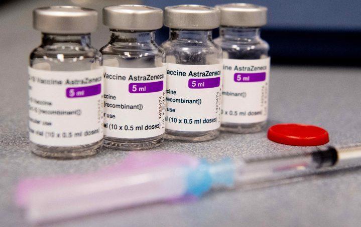 Vials of AstraZeneca COVID-19 vaccine and syringes.