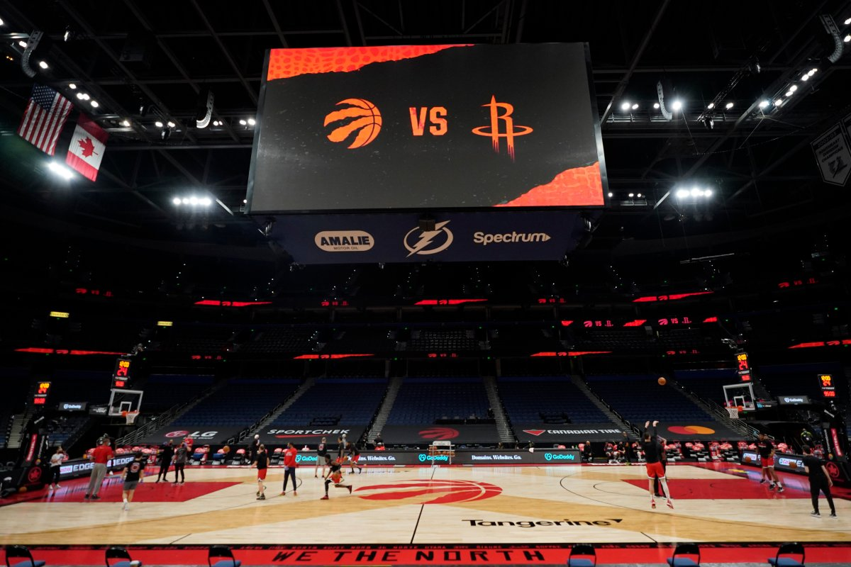 Some members of the Toronto Raptors and Houston Rockets take part in a shoot around before an NBA basketball game Friday, Feb. 26, 2021, in Tampa, Fla.