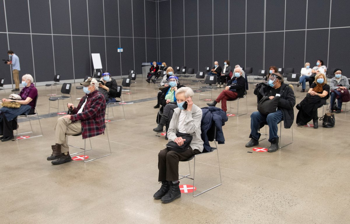 Seniors wait fifteen minutes in the recovery area after receiving their COVID-19 vaccinations at the Palais de Congress site as Quebec begins mass vaccinations based on age across the province, Monday, March 1, 2021  in Montreal.