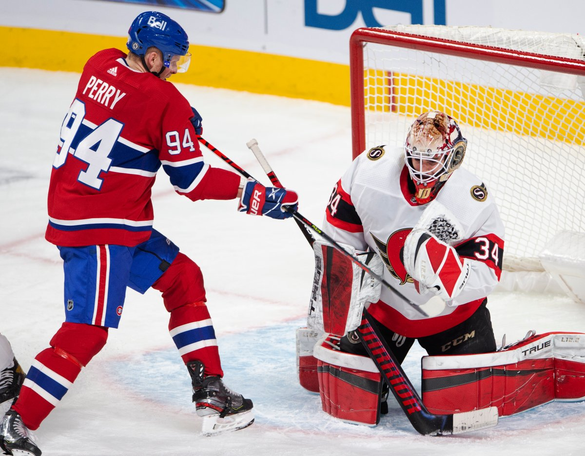 Montreal Canadiens right wing Corey Perry (94) is stopped by Ottawa Senators goaltender Joey Daccord (34) during second period NHL hockey action Tuesday, March 2, 2021 in Montreal.