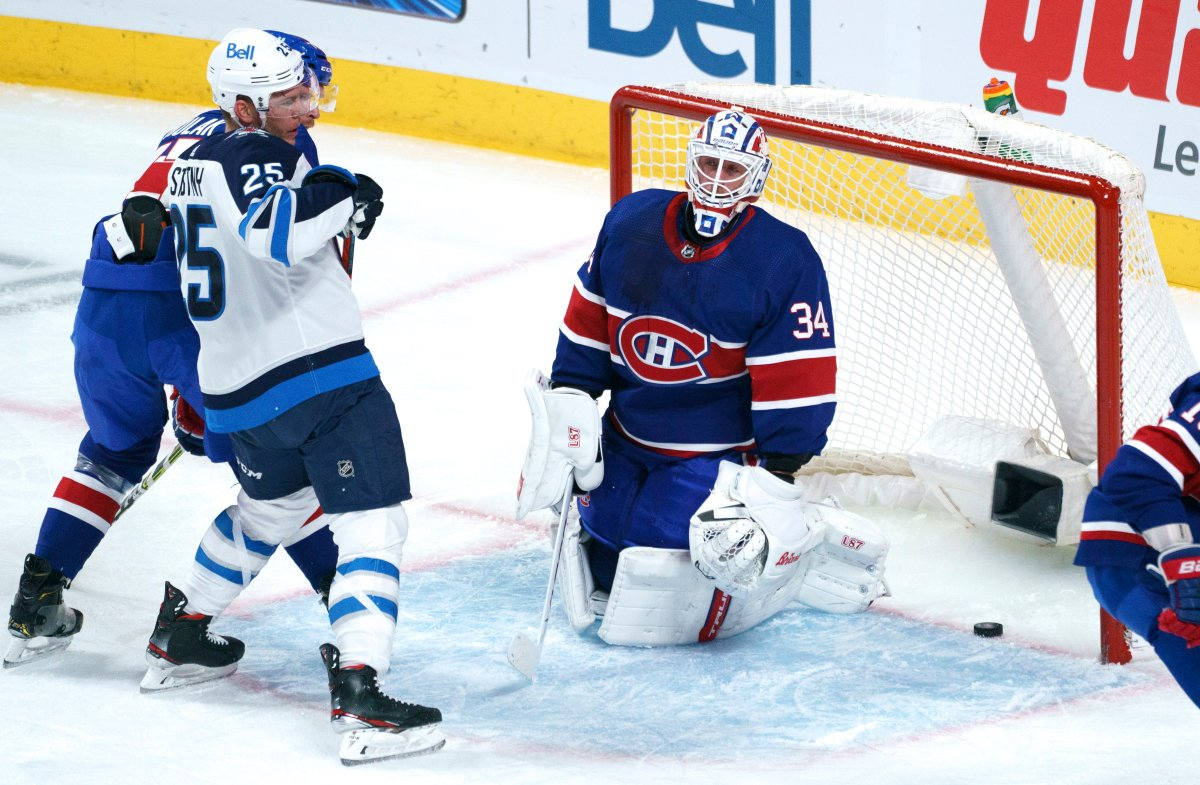 Montreal Canadiens goaltender Jake Allen reacts to a goal by the Winnipeg Jets' Paul Stastny, left, during first period NHL hockey action in Montreal on Thursday, March 4, 2021.