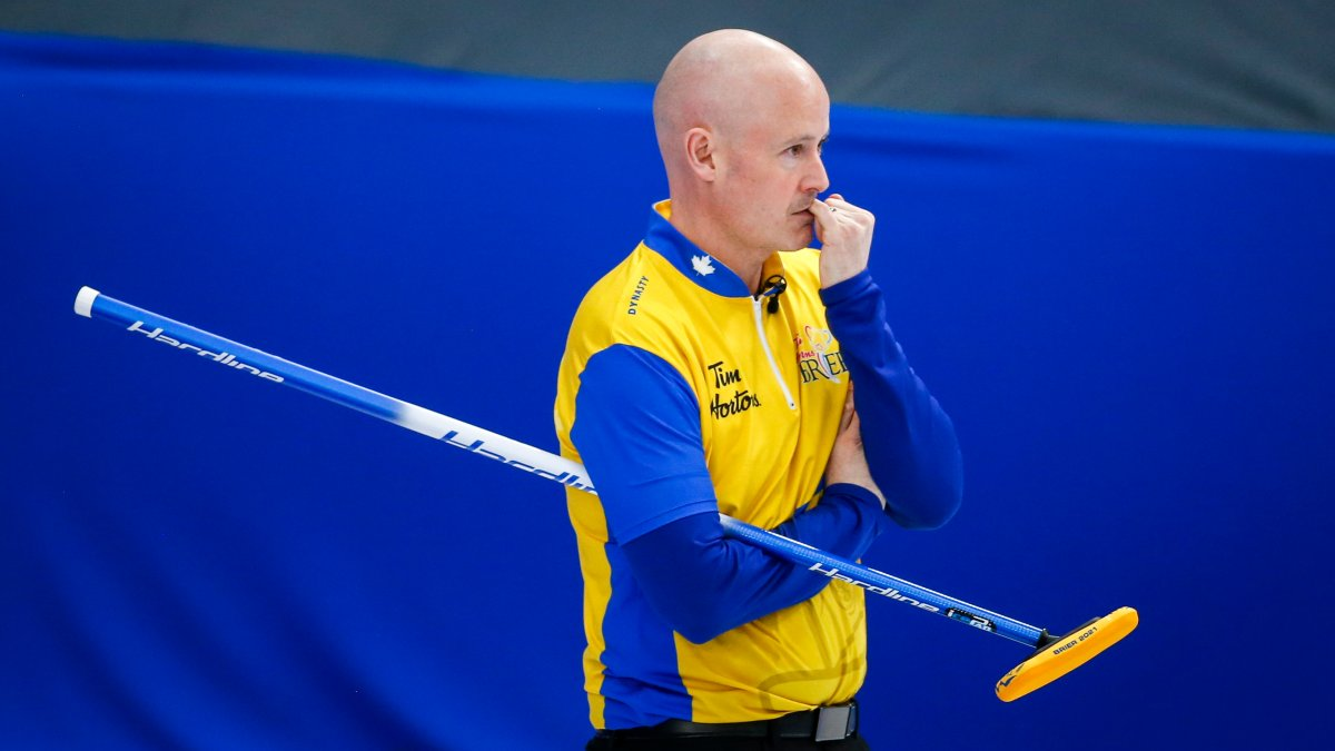Team Wild Card Two skip Kevin Koe watches the action as he plays Team Newfoundland and Labrador  at the Brier in Calgary, Alta., Saturday, March 6, 2021.