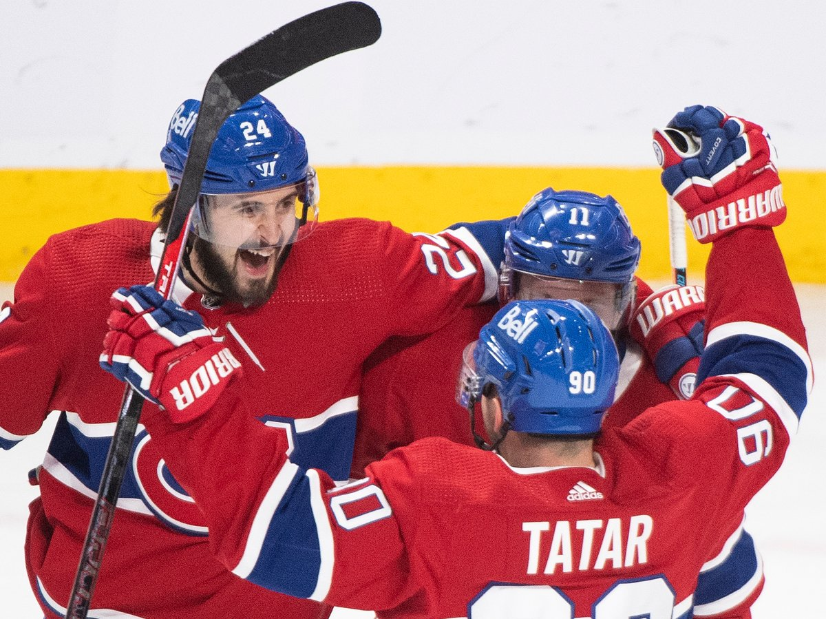 Montreal Canadiens' Brendan Gallagher (11) celebrates with teammates Phillip Danault (24) and Tomas Tatar (90) after scoring against the Winnipeg Jets during second period NHL hockey action in Montreal, Saturday, March 6, 2021.