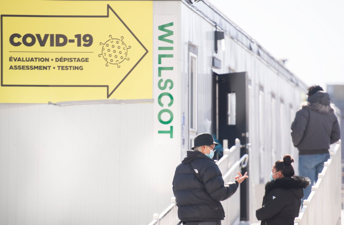 People wait in line to get tested for COVID-19 at a testing clinic in Montreal, Sunday, March 7, 2021, as the COVID-19 pandemic continues in Canada and around the world.