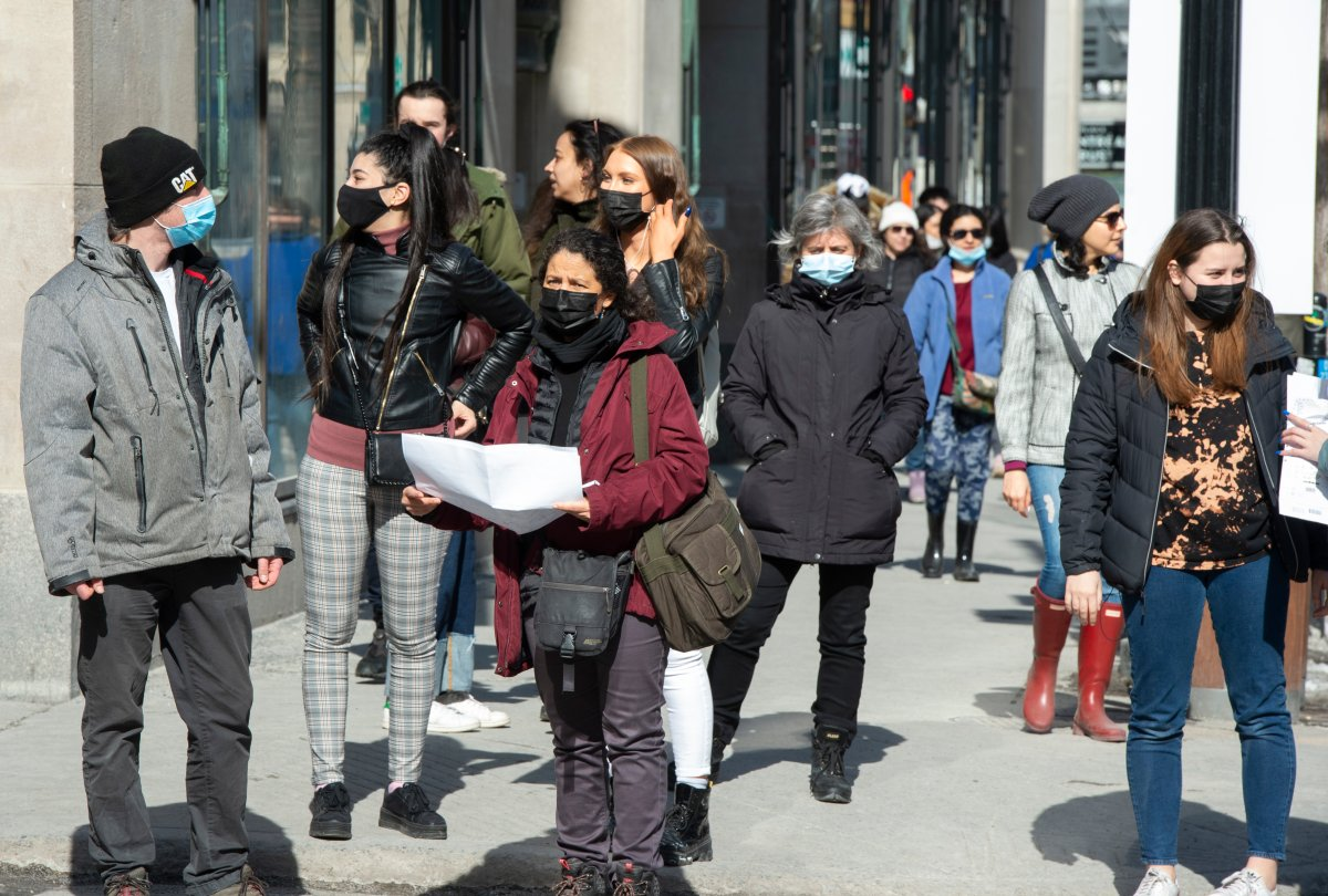Pedestrians make their way along St. Catherine street, Wednesday, March 10, 2021 in Montreal.