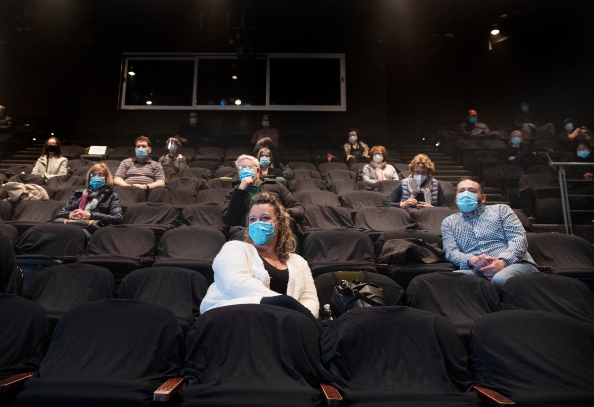 People wear face masks as they wait for the start of a performance of MOB at the Centaur Theatre in Montreal, Sunday, March 28, 2021, as the COVID-19 pandemic continues in Canada and around the world. Certain health and safety measures have been eased in the province of Quebec allowing theatres, churches and gyms to have up to 250 people on their premises.
