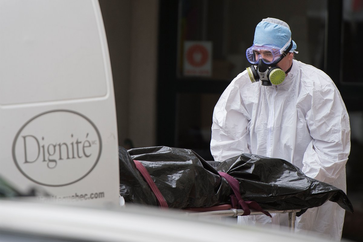 A body is removed from Maison Herron, a long term care home in the Montreal suburb of Dorval, Que., on Saturday, April 11, 2020, as COVID-19 cases rise in Canada and around the world.