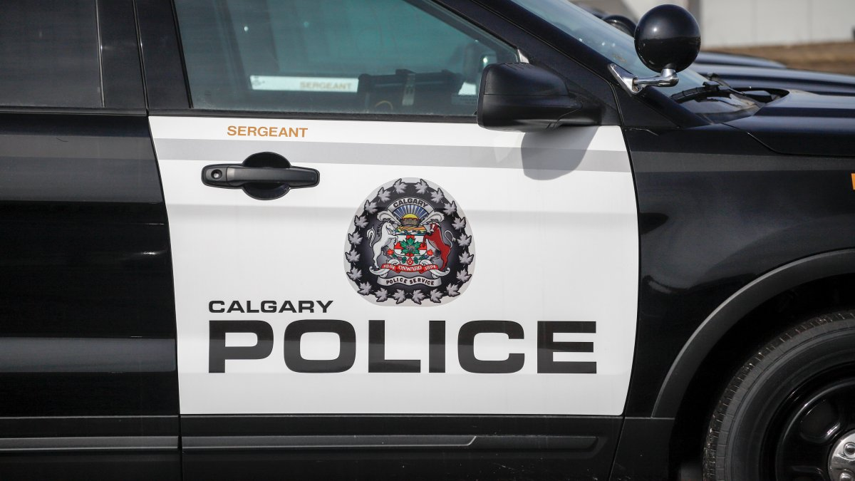 Vehicles are seen at Calgary Police Service headquarters on Thursday, April 9, 2020.