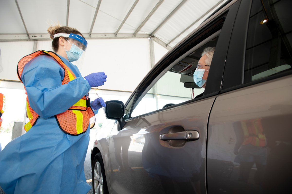 Ottawa Health personnel speak with Roshene Lawson before administering a COVID-19 test at the Coventry Road drive-thru test centre in Ottawa, Friday, Sept. 4, 2020.