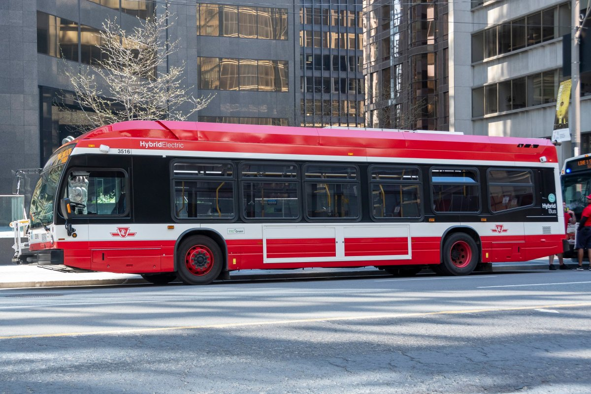 A TTC hybrid electric bus is seen waiting on University Avenue in Toronto on Sunday, May 24, 2020.