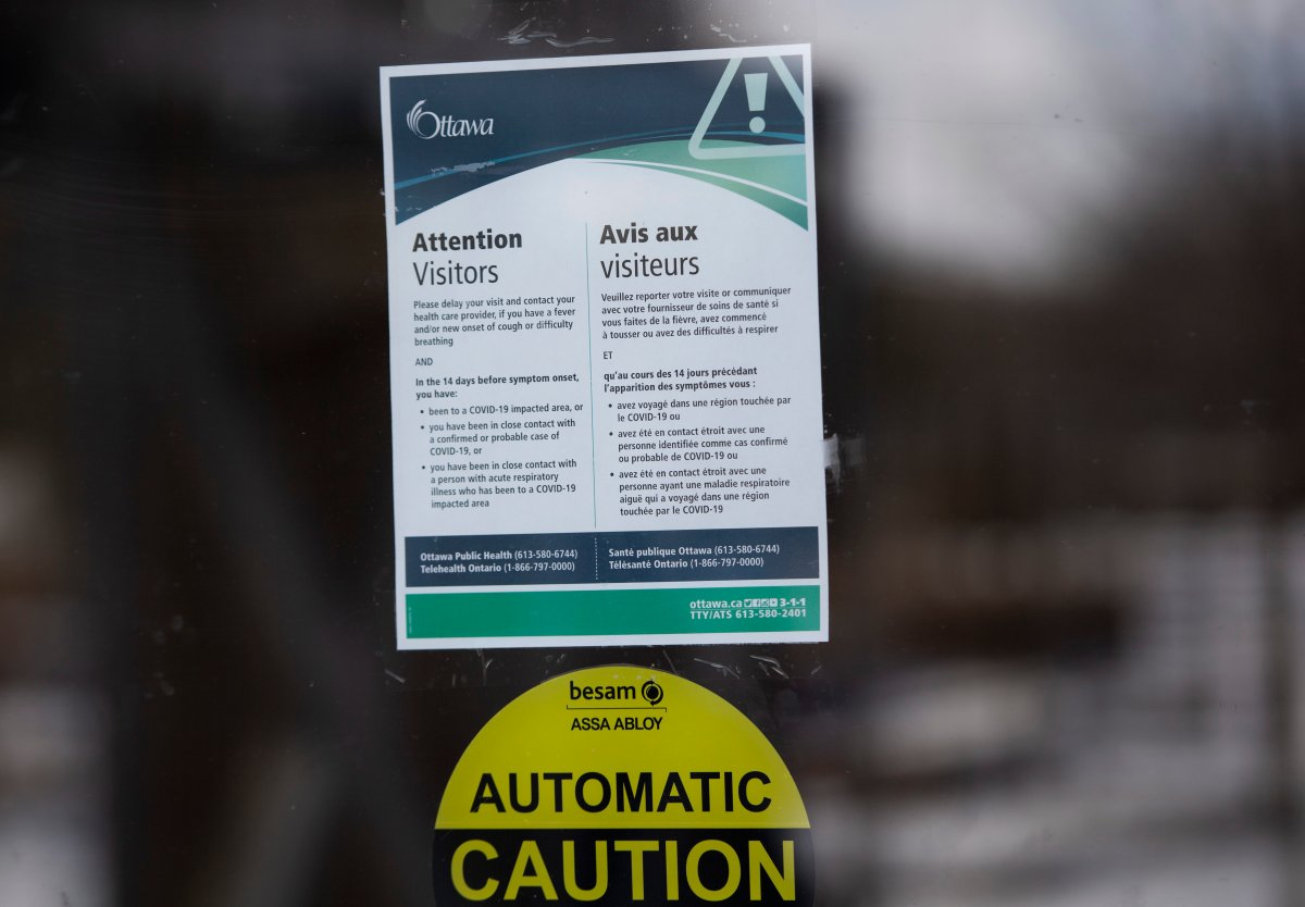 Signage at Lansdowne Park in Ottawa advises residents to delay visiting city facilities amid the COVID-19 pandemic. A shift to Ontario's red zone will indefinitely delay a planned outdoor concert at Lansdowne for later in the month.