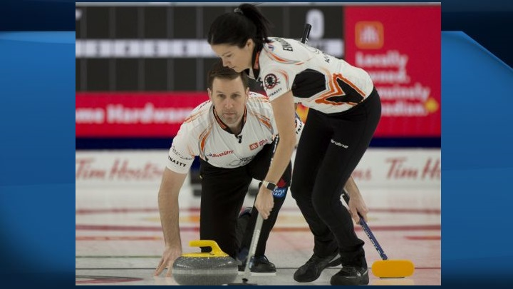 Brad Gushue and Kerry Einarson of Team Einarson/Gushue play a shot during their 11-2 win over Jones/Laing during the Canadian Mixed Double Curling Championship Calgary on Wednesday, March 24, 2021.