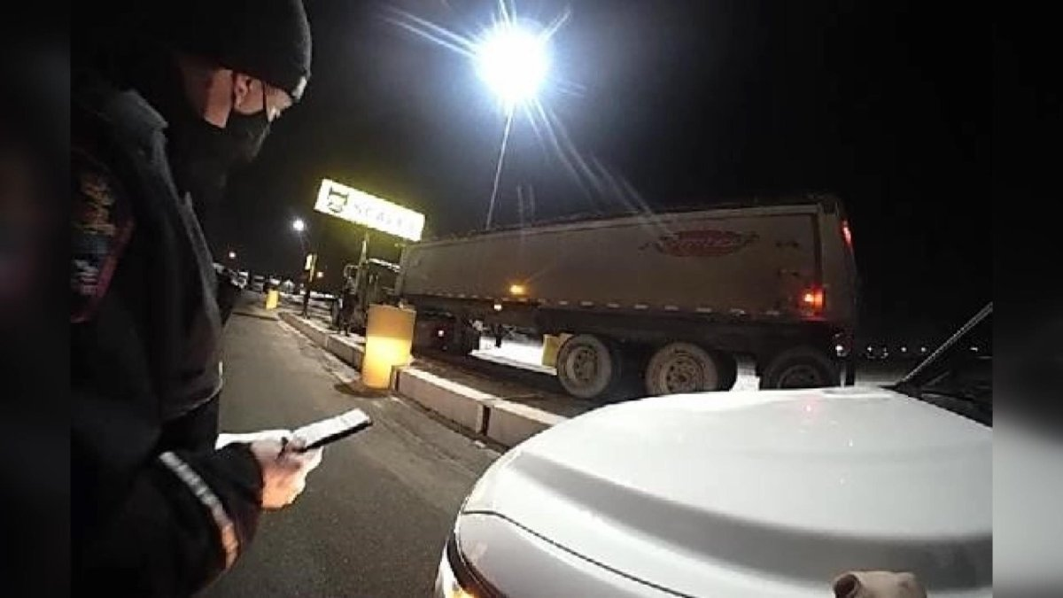 Police say a semi driver is facing over $7,000 in fines and had his licence suspended after being caught over the weight limit and with open beer in his cab.