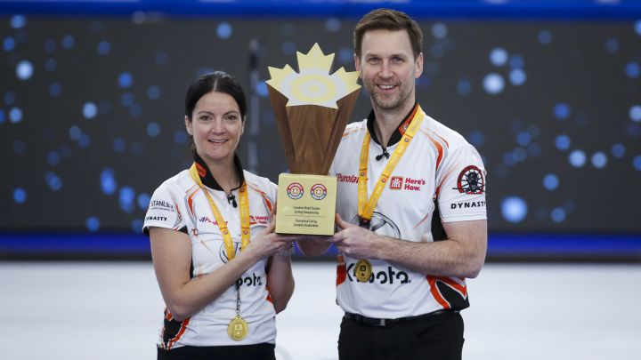 Team Einarson/Gushue skip Kerri Einarson, left, and third Brad Gushue pose with the trophy after defeating Team Sahaidak/Lott at the Canadian Mixed Doubles Curling Championship final in Calgary, Alta., Thursday, March 25, 2021.