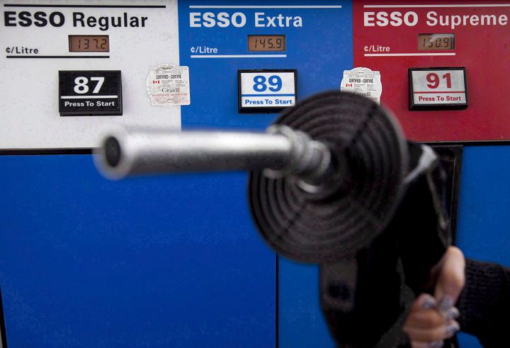 Gas prices are displayed as a motorist prepares to pump gas at a station in North Vancouver, B.C., Tuesday, May 10, 2011.