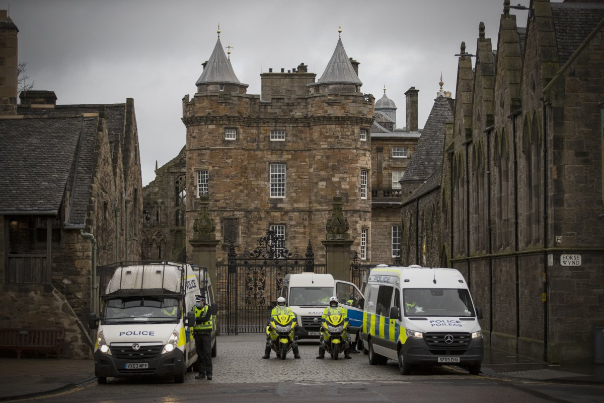 Police during a Scotland Against Lockdown protest outside the Place of Holyrood house opposite the Scottish Parliament in Edinburgh.