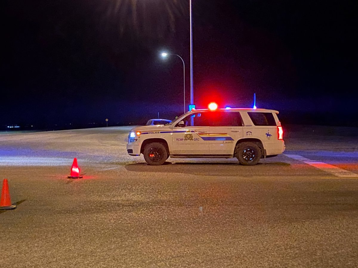 Police on the scene of a standoff in Granum on Tuesday, March 16.