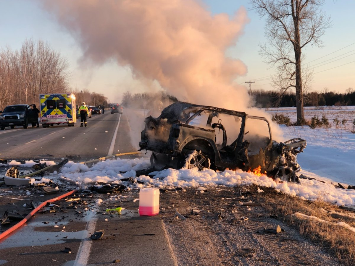 Smoke billows from a vehicle after it was involved in a serious crash in Huron County.