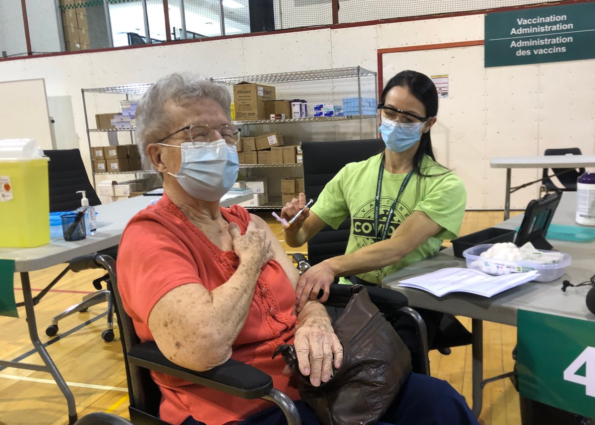 Shirley Banks, 88, receives the first dose during the opening of the North London Optimist Community Centre COVID-19 vaccine clinic on March 17, 2021.