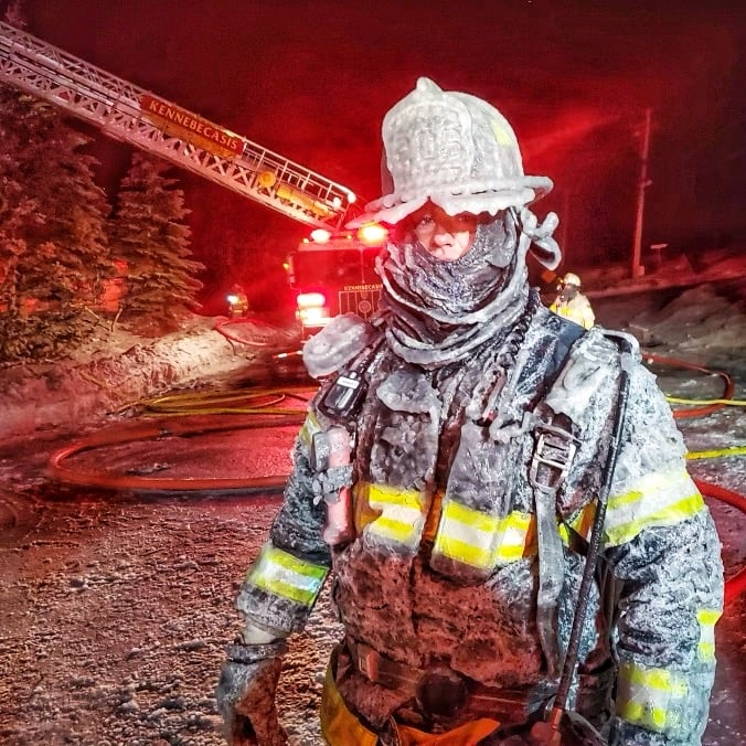 A Kennebecasis Valley firefighter is seen with frozen gear at a fire on Tuesday.