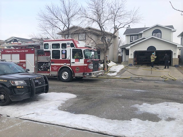 The Calgary Fire department responds to a 911 call for a house fire on Riverbend Crescent southeast on Wednesday, March 10, 2021.