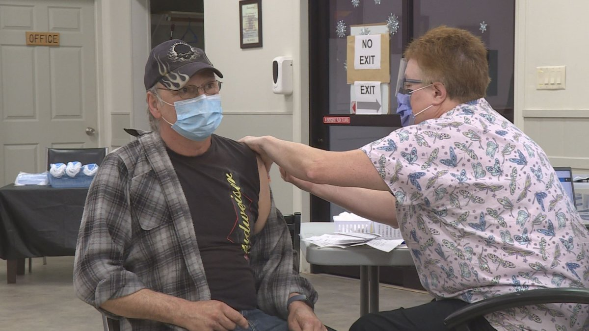 Larry Lafond gets vaccinated at a clinic in Sicamous. Interior Health has set up drop-in hours at vaccine clinics for those needing a first dose.