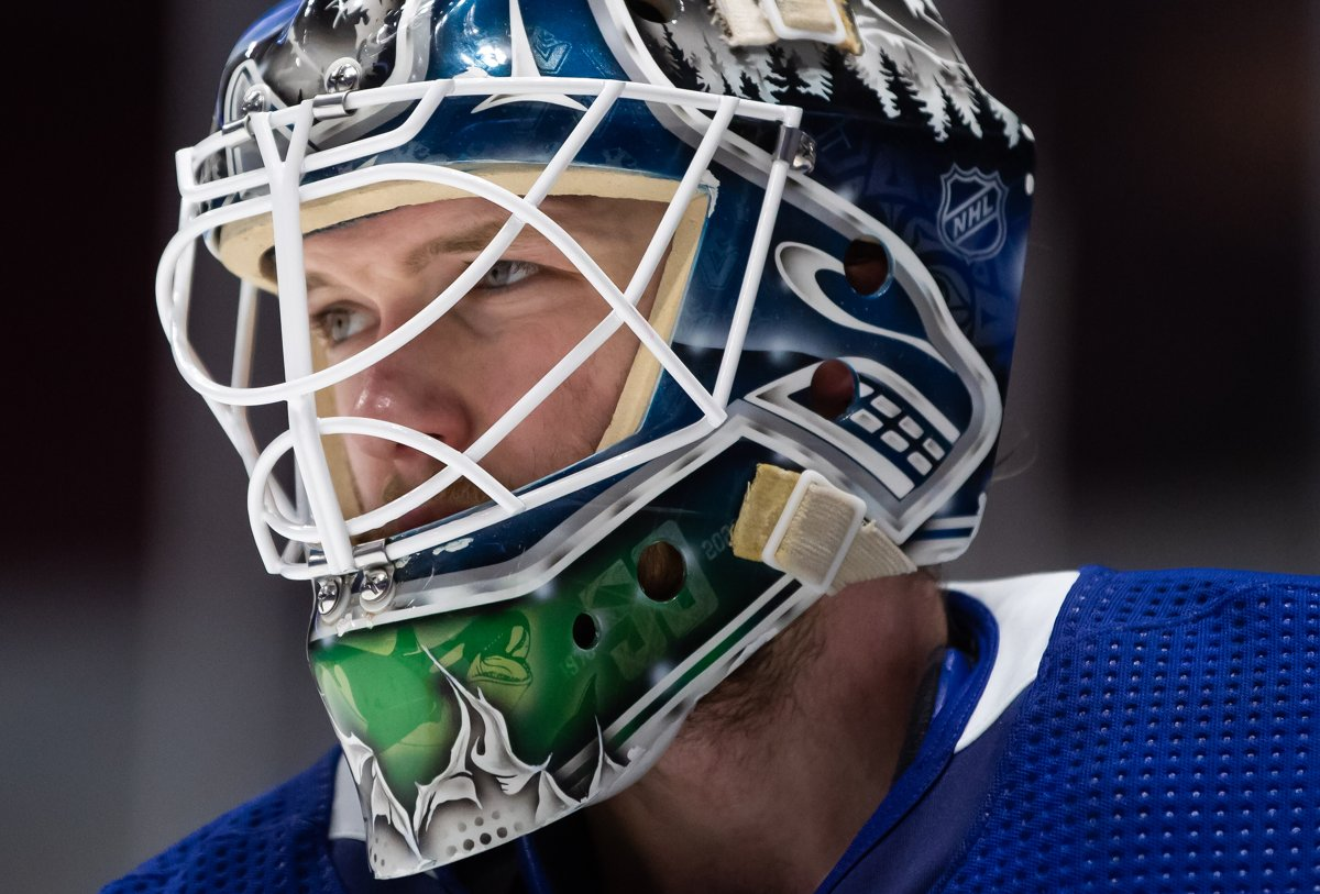 Vancouver Canucks goalie Thatcher Demko looks on during a stoppage in play during the third period of an NHL hockey game against the Edmonton Oilers in Vancouver, on Saturday, March 13, 2021.