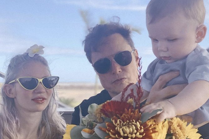Grimes and Elon Musk are shown with their child X Æ A-Xii in Texas.