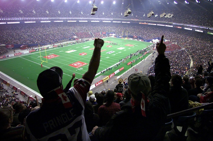FIn this file photo, football fans cheer at the start of the 89th Grey Cup at the Olympic Stadium in Montreal.