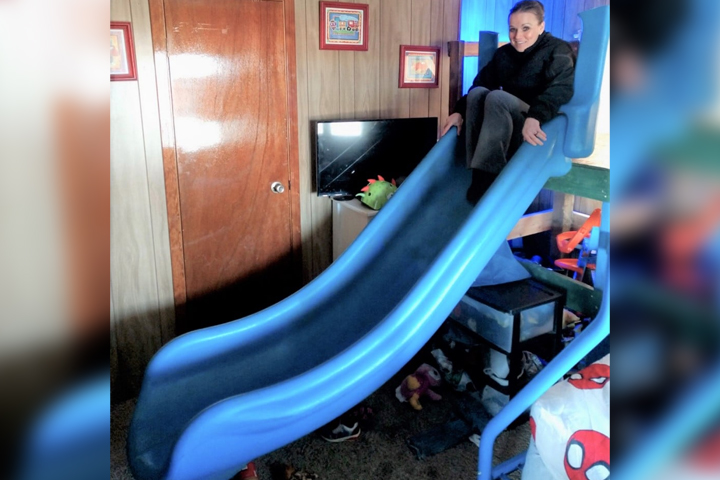 Det. Julie Lee is shown on a missing playground slide inside a suspect's mobile home in Burbank, Wash., in this image released on March 9, 2021.
