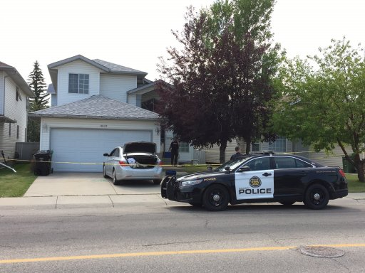 Calgary police at the scene of a home in Hidden Valley where two people were found dead on Tuesday, July 31.
