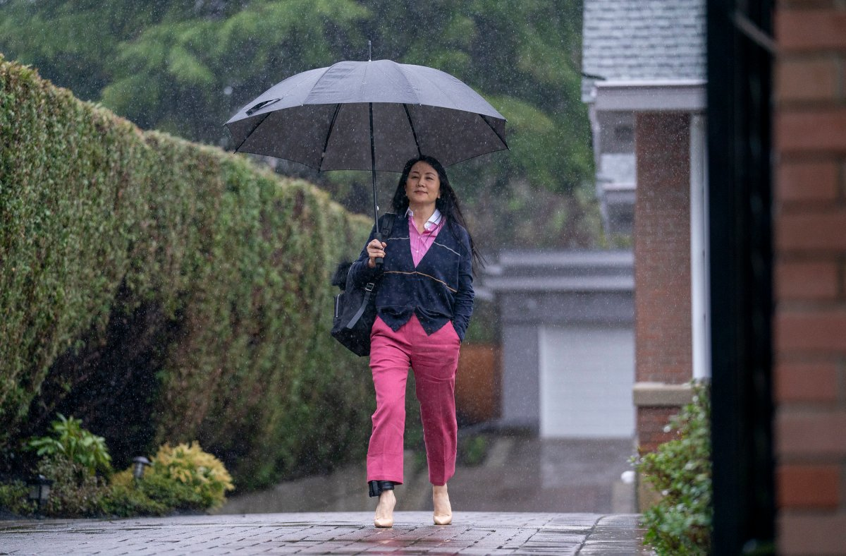 Chief Financial Officer of Huawei, Meng Wanzhou leaves her home in Vancouver, Wednesday, March 24, 2021 to go to B.C. Supreme Court.