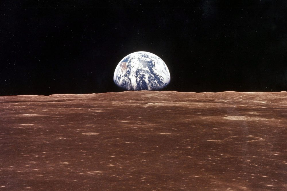 Earth is shown from the moon during the Apollo 11 mission.