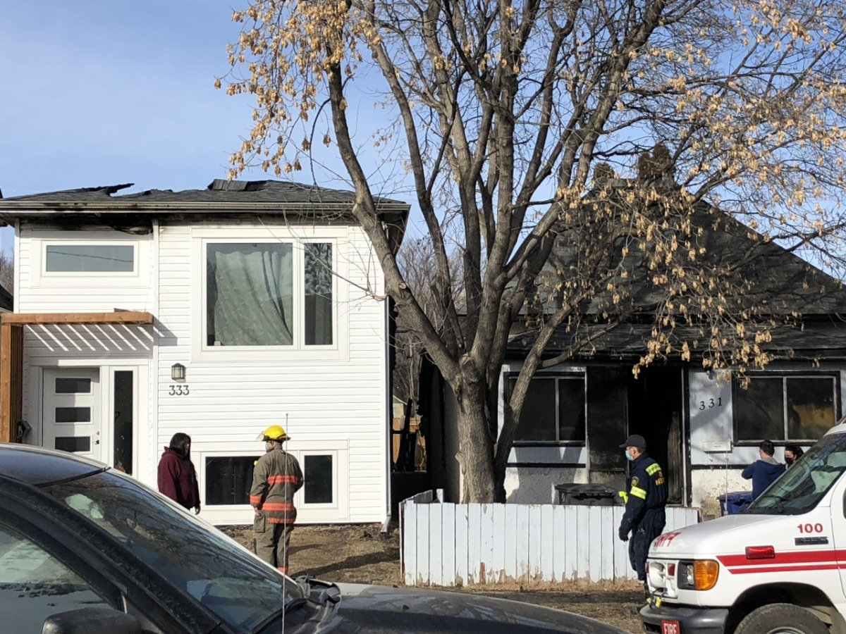 The public is asked to avoid the area of 300 Avenue S South while fire crews and police investigate a house fire in Saskatoon.