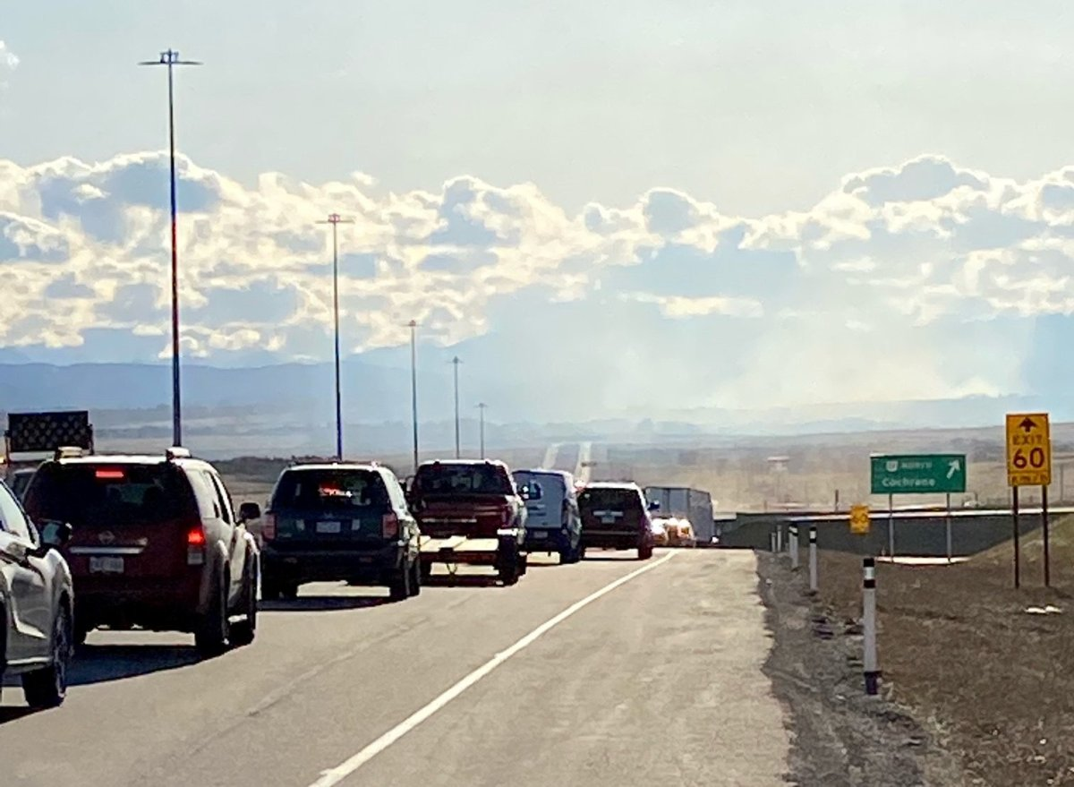 Traffic is being diverted to Highway 22 and Highway 1A due to a grass fire west of Calgary, April 30, 2021.