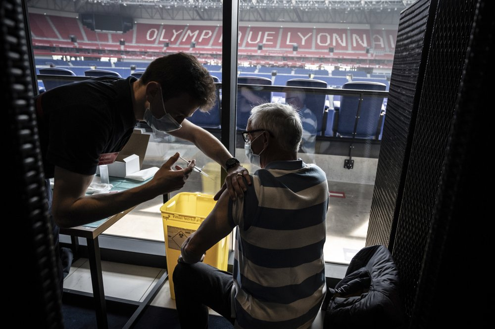 Patients receive an injection of the Moderna Covid-19 vaccine on the opening day of a mass vaccination centre set up in the Olympique Lyonnais soccer Stadium, in Decines-Charpieu, Saturday, April 3, 2021.