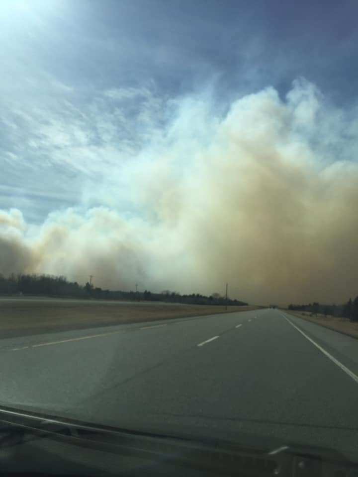 Smoke can be seen from a grass fire burning near Carberry earlier this month.