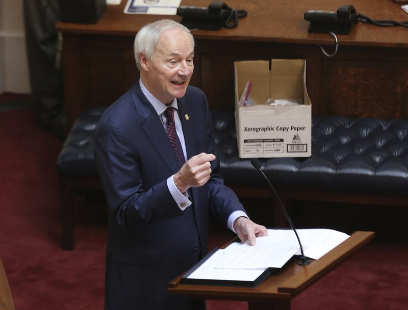 FILE - In this April 8, 2020 photo, Arkansas Gov. Asa Hutchinson gives the State of the State in the senate chamber of the state Capitol in Little Rock, Ark. Hutchinson vetoed legislation that would have made his state the first to ban gender confirming treatments for transgender youth.