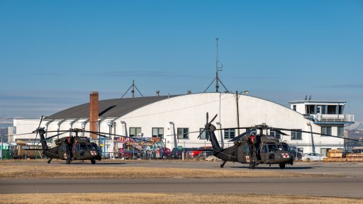 Two U.S. Army National Guard UH-60 Black Hawk helicopters at the Calgary International Airport on April 15, 2021.