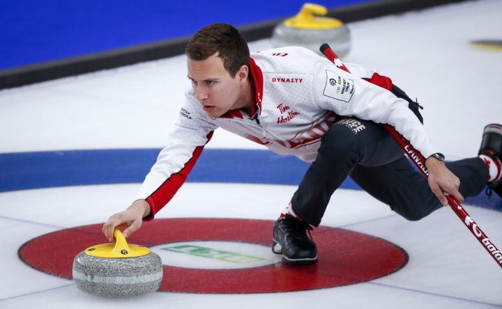 Team Canada skip Brendan Bottcher makes a shot against the United States at the Men's World Curling Championships in Calgary, Alta., Monday, April 5, 2021.