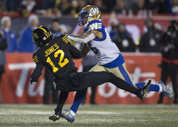 Winnipeg Blue Bombers' Mike Jones tackles Hamilton Tiger-Cats' Mike Jones during the second half of the 107th Grey Cup in Calgary, Alta., Sunday, November 24, 2019.