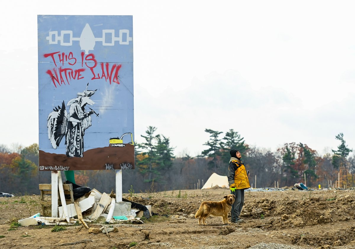 An Indigenous Mohawk called Wack camps out at a construction site at the centre of an Indigenous land dispute in Caledonia, Ont., on Thursday, October 29, 2020. THE CANADIAN PRESS/Nathan Denette.