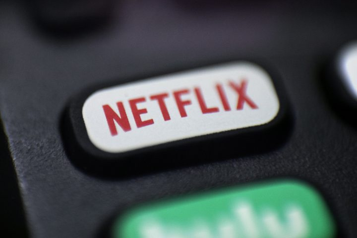 This Aug. 13, 2020, file photo shows a logo for Netflix on a remote control in Portland, Ore.